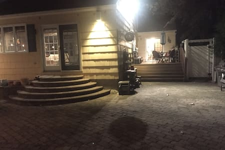Private entrance front yard/patio at night