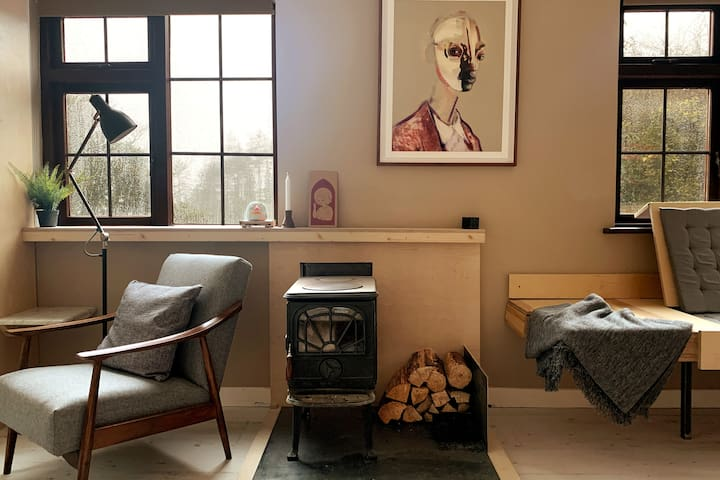 Put your feet up and relax to the sounds of the wood-burning stove.