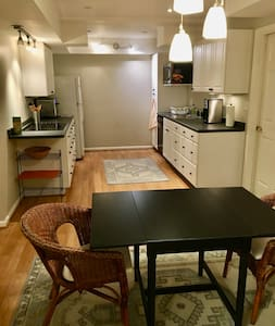 The kitchen is super wide, very spacious in-between the counters.  And there's lots of room to get around the dining table too.
