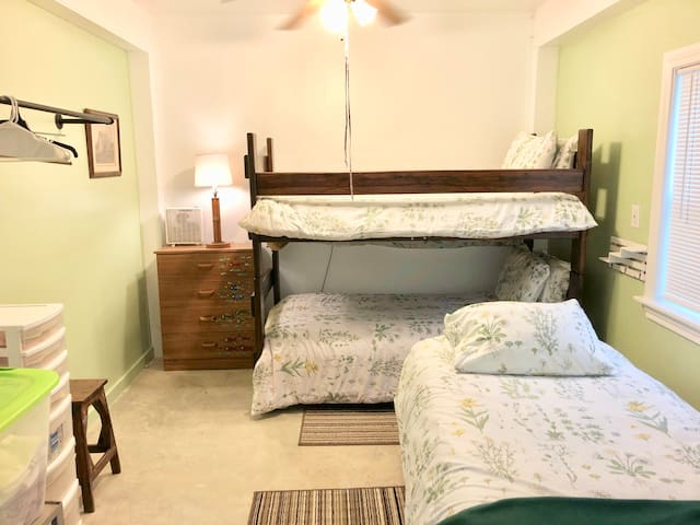 """Downstairs """"Camp"""" bedroom with 3 twin beds"""