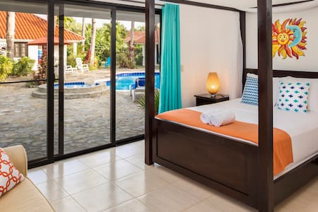Poolside room with queen-sized pillow-top mattress and quality linens.
