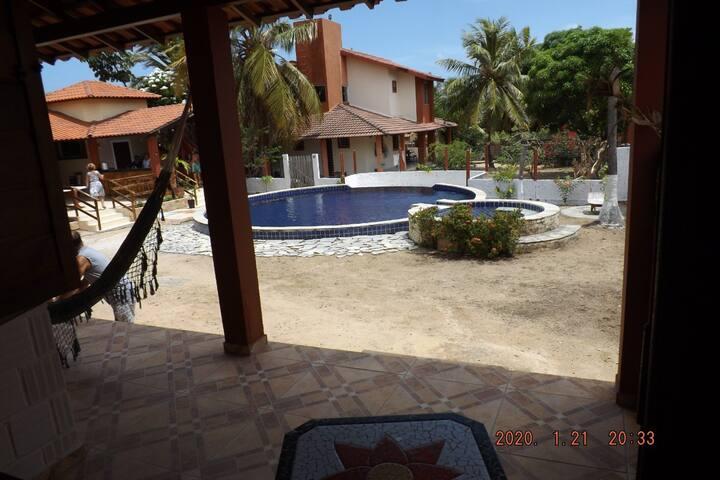 Chalé com piscina e área de lazer em Carapibus