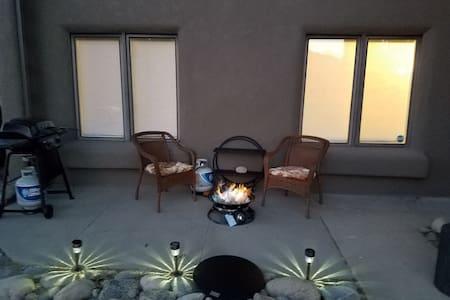 Solar lamps illuminate the patio perimeter at night
