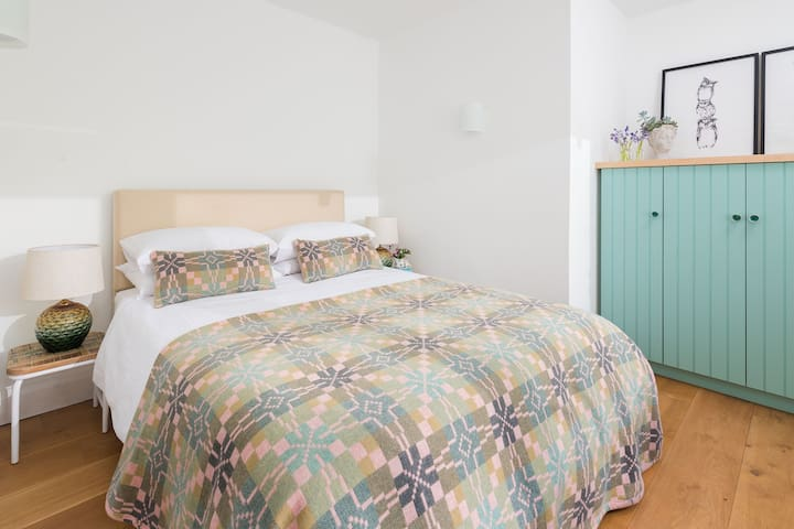 Sunny third bedroom with partial creek view