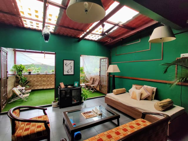 Sun room opens onto covered patio- photo by airbnb guest, Fedora De Souza