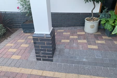 To the left of the step there is an area to access a wheelchair