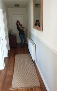 The long hallway, down to the laundry room