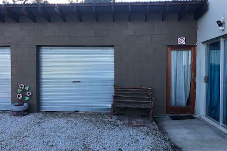 Enter through single glass door in garage, open next 2nd glass door into hallway in house.  Garage door not automatic.  Can go in house and open aluminum sliding doors for wheel chair access or more comfortable unpacking.