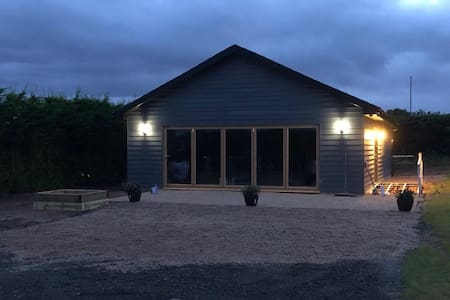 This is The front of the King Richards lodge and shows it's 7 opening Bifold doors with excellent views
