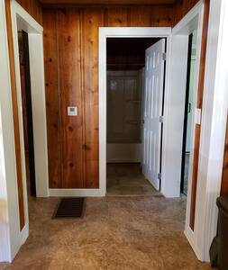 inside the cabin are wide 32 in doors with barn door closings. there is one 4 in step to the inside of the cabin.