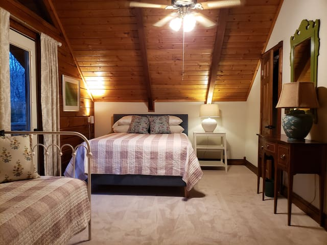 Private loft bedroom with Queen bed and Twin bed.
