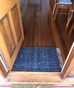 Small step over entry all living and bedrooms, bathrooms level access
