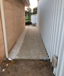 Wide path between the shed (where your car spot is) and the garage (where my cars are)