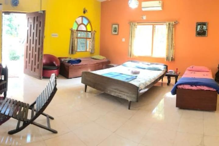 Main room with bedroom and lounge spaces