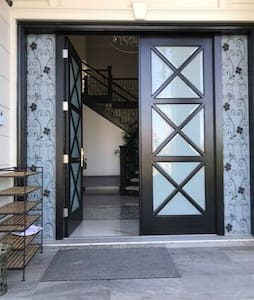 The main door access has a small door frame that is easily accessible. The width of each panel is about 40 inches.
