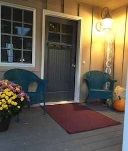 The front door threshold is handicap accessible. There is an ADA ramp that leads directly from the parking area to this entryway door. (See all the photos for 3 views of ramp.)