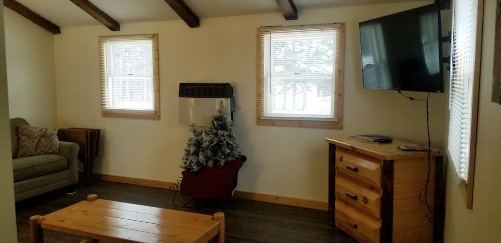 Upstairs living room showing TV with Roku, including Netflix and Amazon subscriptions
