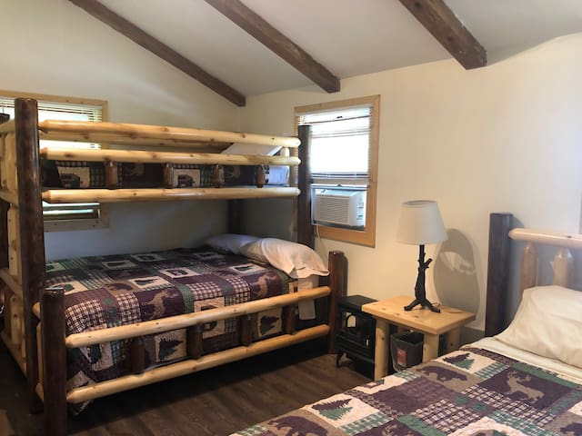 Bedroom 2 in upstairs unit with a twin over full bunk bed and queen bed