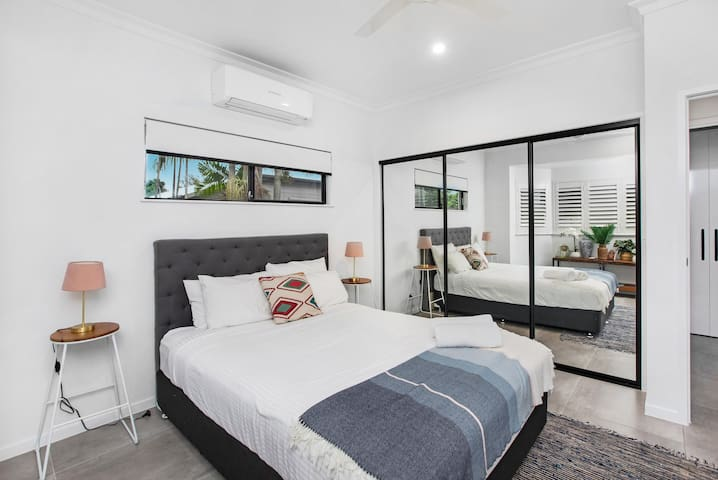 Imagine having a peaceful night's sleep in this very comfortable Queen size bed. This room also has floor to ceiling mirrored wardrobe doors and full airconditioning.