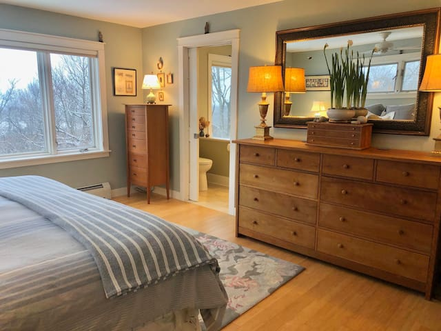 Master bedroom with luxurious king bed wish fresh new linens
