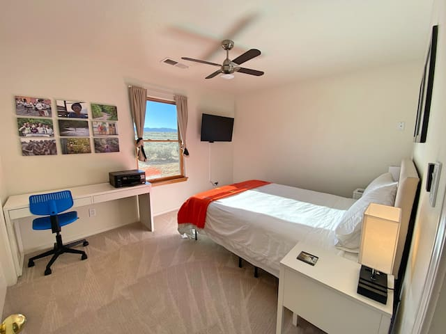 Room to relax and stream your favorite shows on a comfy queen bed with fresh, new bedding.  The bedside lamps have USB ports so bring your cords!  Fast internet and printer provided for those who work from home.