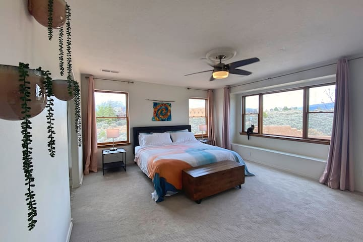 """This spacious master bedroom with en suite bath with stall shower and garden tub is perfect for peaceful, quiet rest. You'll probably be too distracted by the sunrises and beautiful views, but there's also a 60"""" TV with all the apps."""