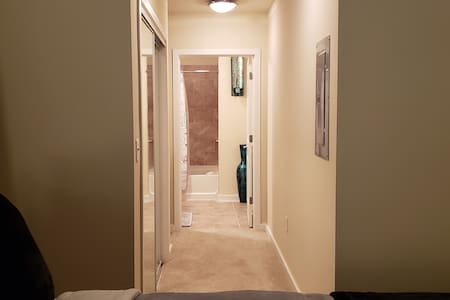 The hallway leading from the bedroom to the master bathroom.