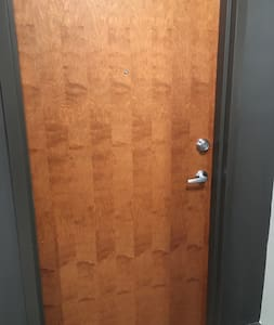 This is the front door leading into the apartment. There are no stairs.