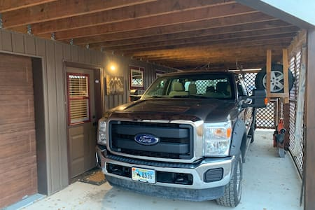 Oversized carport, for ease in loading and unloading luggage.