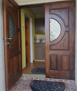 Entrance to your space. Both doors can open out.