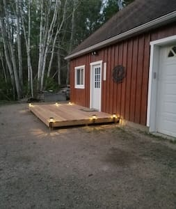 There is a motion-sensor to light the front entrance. Solar lights also surround the steps to the porch.