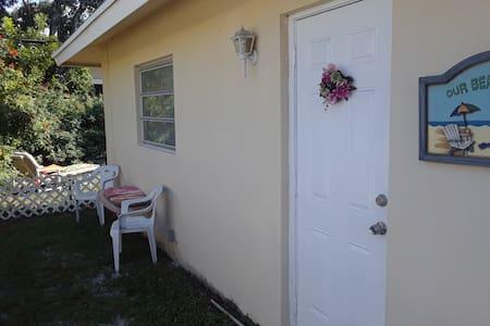 Ground level (door threshold is 4 inches above ground)