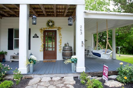 """The door is at least 32"""" wide, however, there is a step up to the porch and a raised threshold to cross in the door frame."""