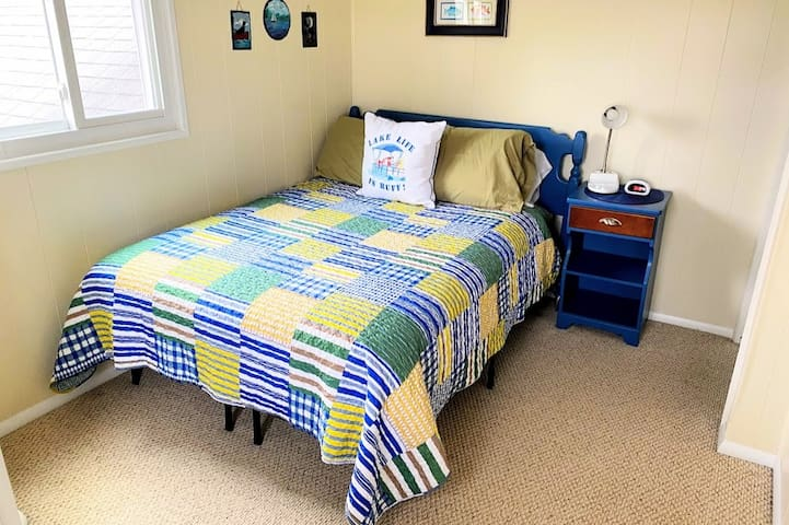 Yellow Bedroom has a brand new full size bed with views of the lake.