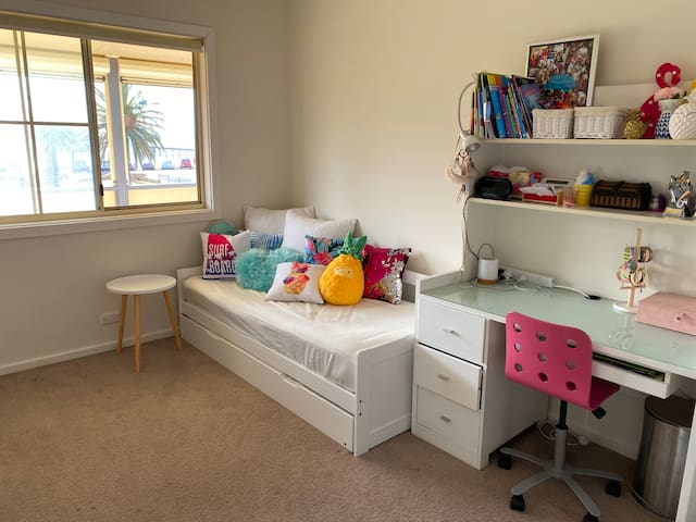 Upstairs single trundle bed