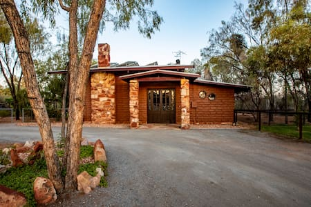 The grand entrance to the Sturt Desert Pea House focuses on the double front door, which has stained glass highlights. A flat driveway provides easy access.