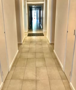A wide corridor leads to the apartment with large space to carry luggage and walk comfortably