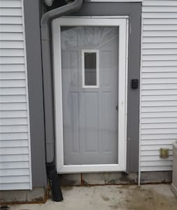 This is the side door on the patio that is the entrance to the apartment.  You first pass thru a white  privacy fence gate.