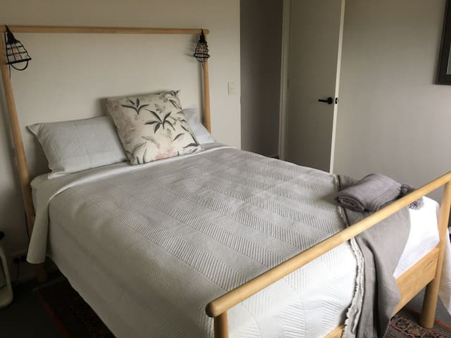 The master bedroom has a comfortable queen bed.