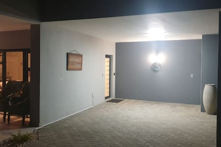 There is a light outside the front door and in the carport. The carport light is also on a motion sensor, for extra convenience and security.