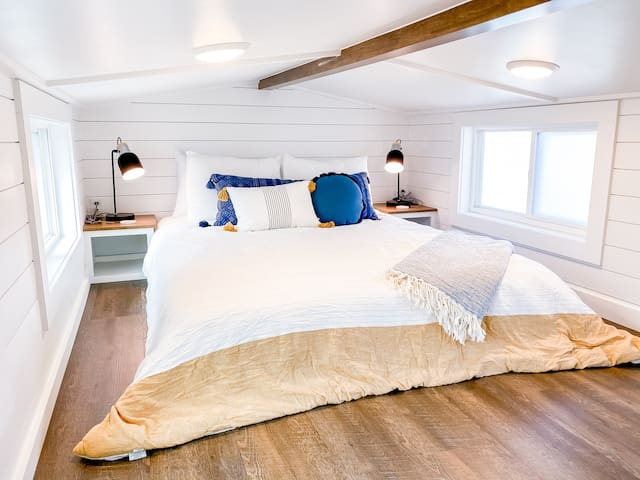 Queen size bed in loft with luxury microfiber sheets.