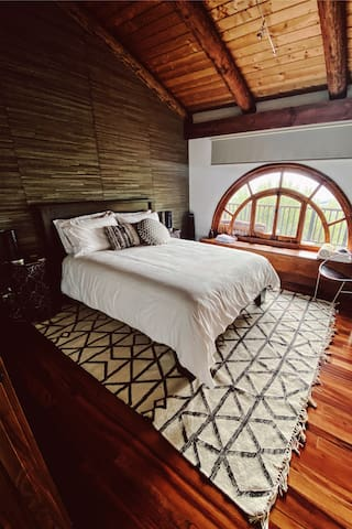 Our beautiful second bedroom with views of the mountains and red rock.