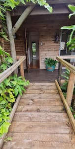 Photo of front entrance from ramp. Note bathroom directly in line with front door with access through door to back verandah.