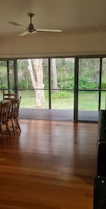 Double glass sliding doors for alternative entry into cottage from front verandah. 188cm wide space with verandah deck flush with internal floor. Photograph taken from kitchen bench.