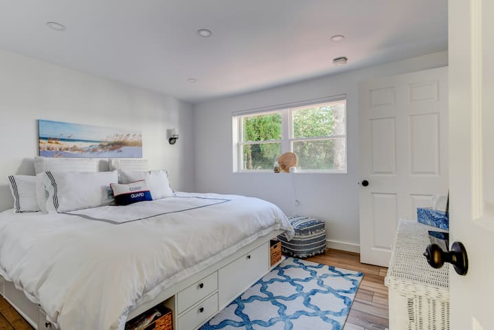 [lower level] master bedroom with water view