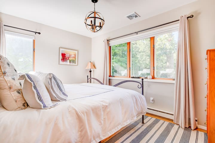 [upper level] master bedroom with water view