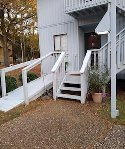 Handicap ramp access or stairs, each well lit by sidewalk light.