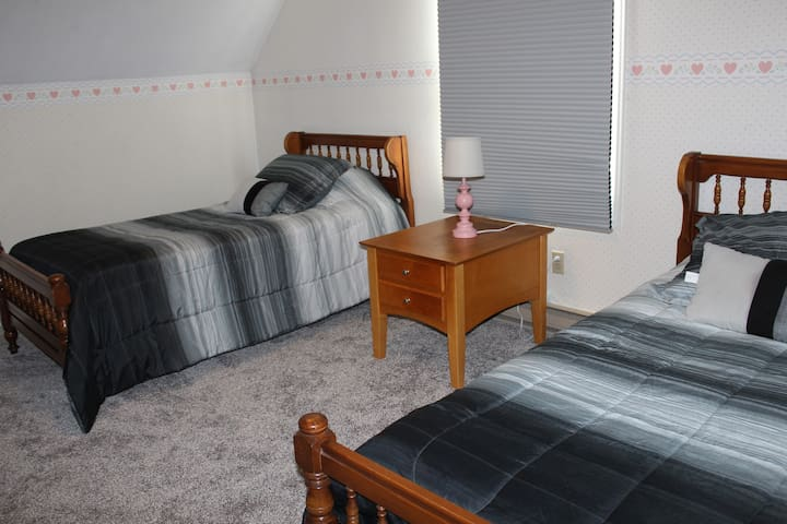 Bedroom 7.  Two twin beds.  Third floor.  New carpet and blinds 6-21.