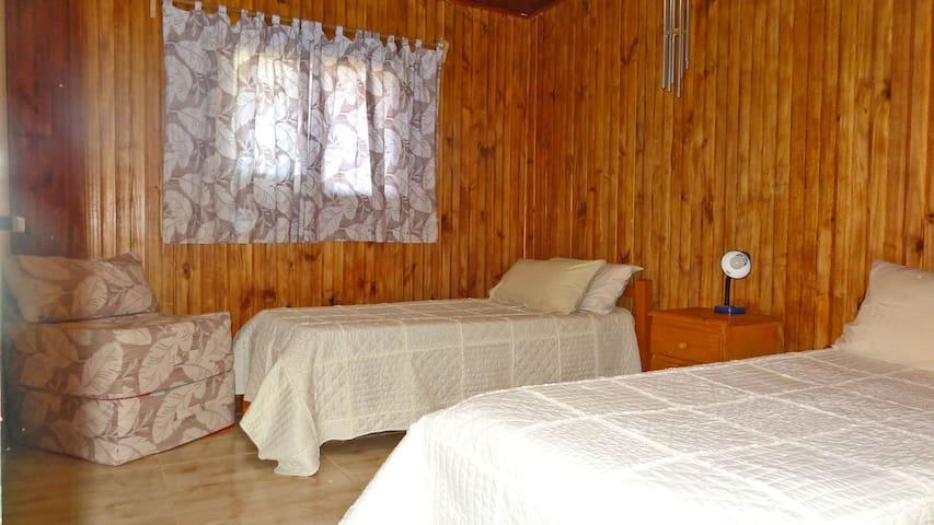 Room no 3 with two single beds and two foldable mattresses  Habitación no 3 con dos camas individuales y dos colchones plegables