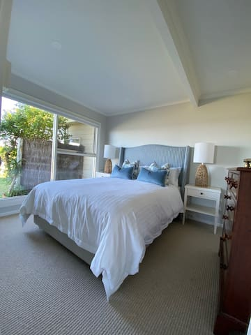 Gentle ocean sounds will be your lullaby at Harbour Masters Apartment.  The bedroom has views of the garden and ocean.